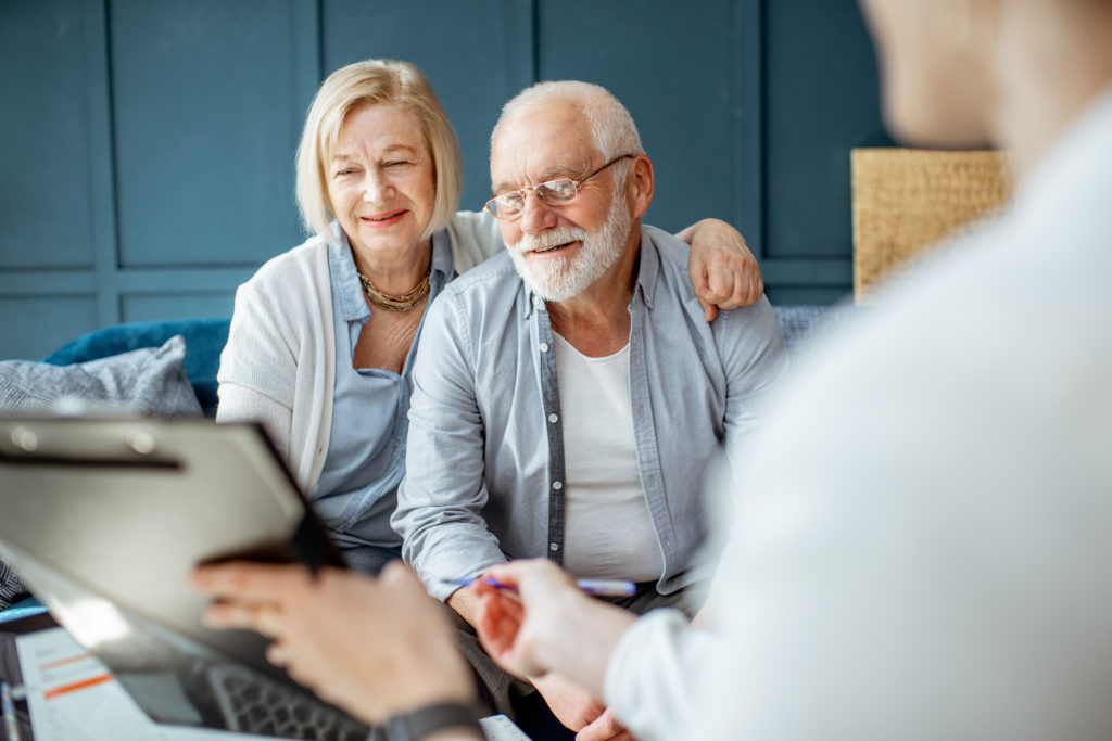 a senior couple working with an accountant for estate planning