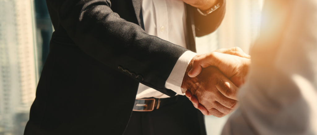 a business man shaking hands with his CPA after receiving a business valuation