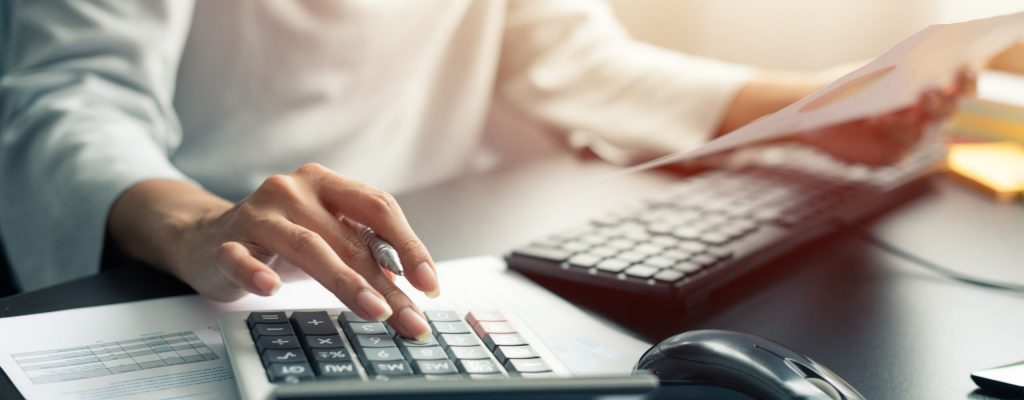 An accountant working on accounting services with a calculator